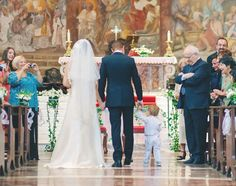 Ahh love this! the bride, groom, and son walking down the aisle after <3