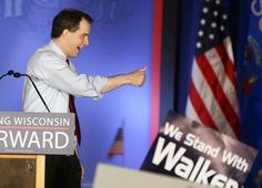 Wisconsin Gov. Scott Walker celebrates his victory in Waukesha.  He celebrated, then turned around and shafted all his public employees.