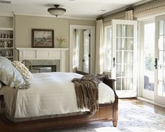 Curtains on either side of french doors with roman blinds hung above door.