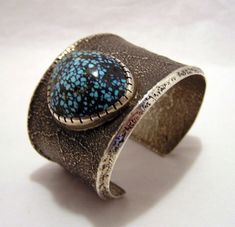 Silver cuff bracelet by world famous Hopi Indian artist Charles Loloma. A large top quality Lander Blue turquoise, 35-40 carats, is off set in a silver bezel on the deeply textured tufa cast band.  Charles Loloma is revered as the most innovative Indian artist of the twentieth century. His departure from the status quo of Indian style jewelry changed American Indian arts forever. Some of Loloma's first jewelry entries at the Gallup Indian Ceremonial were turned down as being too…