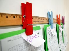 Kids love to display their good grades and artwork, whether it's on the refrigerator or in their bedroom for daily motivation. Give them a place that's truly their own to showcase their proud markings by revamping a yardstick into a kids' clip-art rail. Simply add colorful extra-large clothespins to a yardstick and attach. Each pin will be easy for little hands to clip up their favorite drawings, photos and awards. Photo courtesy of Ana White