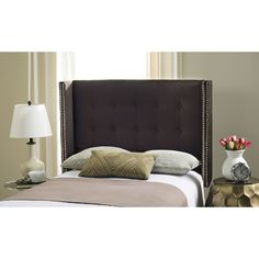 Inspired by the relaxed luxury the defines classic New England style, this linen headboard is a designer favorite. Its clean lines and polished nailhead trim atop classic chocolate upholstery create an aura of stately elegance in any bedroom.