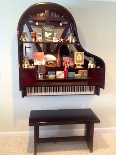 Baby grand piano repurposed into a bookshelf with a bench built from salvaged boards