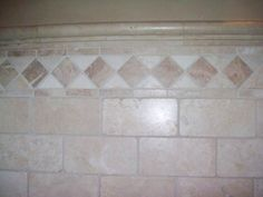 Bathroom tile with natural stone border.