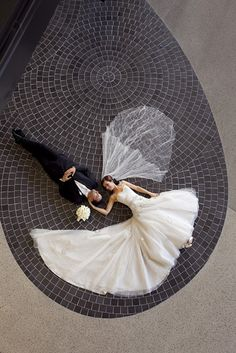 So elegant and beautiful!  Both laying down,with gown and veil spread out