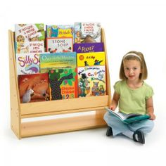 """Value Line Book Display (Natural) (29""""H x 28""""W x 10""""D) by Angeles. $115.00. 4 Upper shelves and 1 bottom storage area. Color: Natural. Size: 29""""H x 28""""W x 10""""D. Makes book selection easy. Rounded edges for safety. The Value Line Book Display by Angeles allows books to face outward for easy viewing and selection. It makes a wonderful addition to kids' bedrooms, day cares and classrooms. The bookshelf has 4 upper shelves plus a large lower storage section. C..."""
