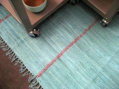 Create a quick inexpensive blast of color. DIY rug made from 3 cheap rugs and a skein of red yarn. Area Rugs Cheap, Cheap Rugs, Small Area Rugs, Do It Yourself Design, Do It Yourself Inspiration, Big Rugs, Large Rugs, Inexpensive Rugs, Types Of Carpet