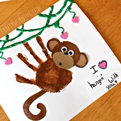 "Make a cute handprint monkey for a valentine's day craft! It says ""I love hanging with you"" for a homemade card."