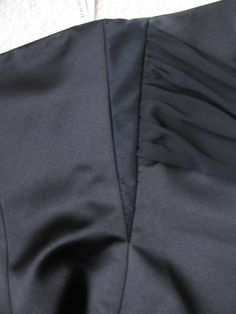 Do you know what a gusset is? It's an inverted triangular piece of fabric used to enlarge a garment so it will fit. Usually, you have two gussets….one in each side seam. You know you ne…