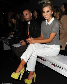 Quick change: Earlier in this day, Mollie wore white trousers and a sheer spotted grey top for the Jean-Pierre Braganza Fashion Show