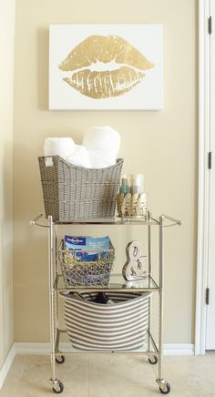 Bathroom Storage Solutions - Add a small tiered cart and baskets to hide bathroom clutter. Click for more bathroom organization tips!