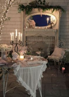 "great mantle, candelabras and shabby chic outdoor ""room"""