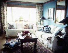 Love the pattern-mixing and the blue shade of the walls. Sara Gilbane Designs