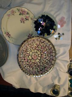 Vintage china, iridescent stained glass tile, mirror tile and a thrift store wooden bowl.