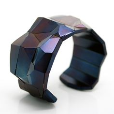 "The Faceted Bridge Cuff, which is 3.00"" x 1.50"" x 2.25"", is made from Faceted Steel. The choice of material impacts how the wearer engages with the art jewelry.David Choi"