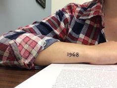 """Little """"1968"""" wrist tattoo."""