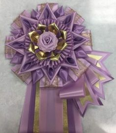 View our collection of ribbons and rosettes available in accents including floral, patterned, glittery golds, silvers and more. Ribbon Rosettes, Ribbons, Homecoming Mums, Centaur, Ribbon Work, Fabric Flowers, Photo Galleries, Arts And Crafts, Spirit