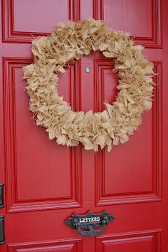 Easy DIY Burlap Wreath -Love how easy and cute this is! Definitely would add some embellishments though.