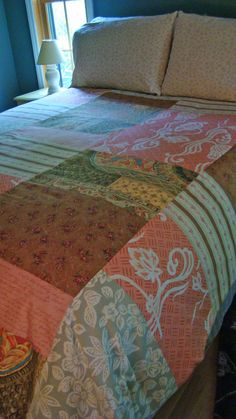 As the nights grow cooler, it's time to turn off the air conditioner, open the windows, and snuggle under a cozy  comforter. Give yours a new look with this easy-to-sew cover.