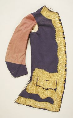 Matching sleeved waistcoat, suit, c1760. Waistcoats like this seldom survive. Although almost entirely covered by the coat, the waistcoat has just as much gold thread & as many gold buttons. The plain sleeves would have been for warmth, an extra layer in drafty, elegant rooms.
