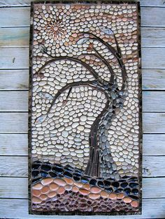 It's very brown and the sun looks a bit lost, but i'm generally happy.......60 x 30cm with mostly pebbles.  Border is polished marble, leaves are crazy lace agate and the tree trunk is slate. I had so much fun doing this! Grouting was pretty laborious though, my fingers were completely wrinkled!