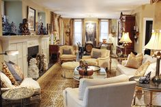 FIFI & COCO | PJ's Living Room & Dining Room Features Elegant Golden Hues to Add a Warmth to the Room | Also Shown: Custom Mantle, Ginger Jars, Leopard Print Area Rug, Henredon Sofa, Minton Spidel Coffee Table & Baker Chairs