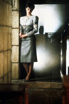 Sean Young as the replicant Rachael in Bladerunner (Dir. Ridley Scott, 1982) - dress designed by Charles Knode, who did her wonderful film noir of the future wardrobe in the film.