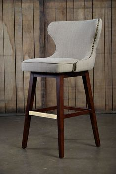 Carney Swivel Bar Stool in Beige Upholstery with Tufted Back and Antique Brass Nail Head Trim, No Finish Options  Also Available in Counter Height 23.75