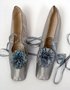 Ca.1860 pale blue silk satin ball slippers owned by the Empress Eugenie. Bowes Museum.
