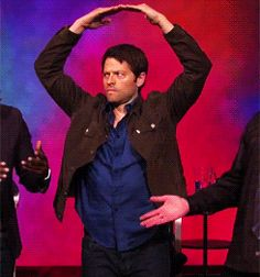 """He looks like Cas here, he's so serious. """"Dean. Dean, I don't understand. Why do I need to twirl in a circle while holding my hands over my head? Dean?"""""""