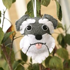 This Schnauzer ornament is completely hand stitched and embroidered. Each ornament is completely unique and different. It measures about 3.75 tall