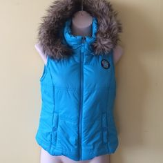 Aeropostale Hooded Vest Pretty turquoise blue vest. ip off hood with faux fur trim. 100% polyester shell and lining and 100% polyfill. Excellent condition.. Aeropostale Jackets & Coats Vests