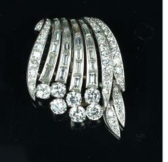 A diamond clip brooch,