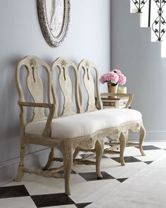 "super frenchy : $3799 Three distinct chair backs, each featuring elegant curves, intertwine to form the back of this breathtaking Swedish-Rococo-style bench. Reproduced from a European original, it offers a unique seating option formal enough for grand dining rooms yet casual enough for entryways, bedrooms, or other areas.  Hand carved of birch; no two are exactly alike.  Seat upholstered in poly/cotton.  Hand-painted finish.  64""W x 20""D x 42""T; seat height, 20""T.  Imported."