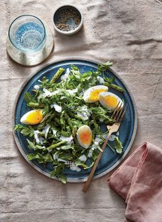 Arugula, Egg, and Charred Asparagus Salad | Just a hint of char on the asparagus adds fantastic complexity to this simple 5-ingredient spring salad. Look for medium stalks rather than pencil-thin ones—those would char and dry out too quickly. A soft-boiled egg adds protein and richness; let the slightly runny yolks mingle with the rest of the salad before enjoying. Whole-milk Greek yogurt has a lusciousness and milder tang than lower-fat yogurt. It's the perfect binder for the lemony…