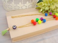 Greek Gold Tone Evil Eye Rainbow Tassel Necklace Purple Bead Red Orange Yellow Green Blue by ForThatSpecialDay on Etsy