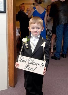 Our handsome ring bearer. Last Chance to Run sign from Etsy  https://www.etsy.com/listing/185237726/rustic-wedding-sign-last-chance-to-run?ref=sr_gallery_7&ga_search_type=all&ga_view_type=gallery