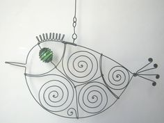 This mobile sculpture consists of 3 wire birds which hang from two wire hangers. The upper hanger is 27 cm (10.6) wide and the lower one 23 cm (9.1)