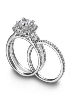 i love how the wedding band fits inside of the engagement ring. this is genius!