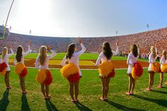 USC's Song Girl Squad cheer on the USC Trojan Football team at the Los Angeles Memorial Coliseum.