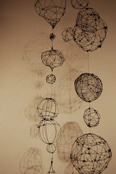 Hanging Wire Orbs & Pods. 2009, Annealed steel wire forms by Barbara Gilhooly http://www.flickr.com/photos/gilhooly_studio/