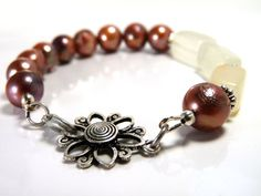 Rosy red pearl and soft gold onyx bracelet. . . with a Daisy!! by ksyardbird