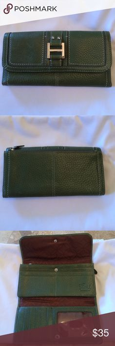 📢 Fossil Large Green Wallet Fossil Large Green Wallet - Must See!  This wallet has plenty of compartments. Zipper compartment on back, inside has an e landing section with zipper and two compartments, 11 credit card slots and an ID compartment. Snap closure front.  This wallet holds a lot!  Great condition and smoke free home!  Approx 7.5L x 4H. Make a reasonable offer and I will be happy to accept! Fossil Bags Wallets