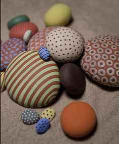 Painted ceramic stones by Daphne Verley  http://www.daphneverley.com/clay/