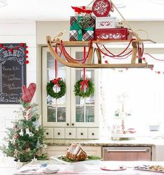 christmas home Vintage sled with presents hung over island in farmhouse style kitchen as Christmas decor Christmas Kitchen, Noel Christmas, Rustic Christmas, Tartan Christmas, Southern Christmas, Christmas Mantles, Silver Christmas, Victorian Christmas, Christmas Design