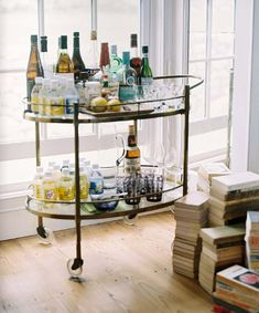 Now this is a fully stocked home bar. Tiny tonic and soda bottles, lemons, and bloody mary fixings create luxury.