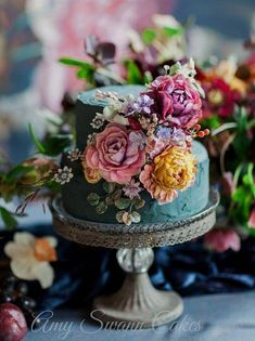 This gorgeous two tiered floral wedding cake is packed with vibrant colour and detail. This gorgeous two tiered floral wedding cake is packed with vibrant colour and detail. 2 Tier Wedding Cakes, Floral Wedding Cakes, Wedding Cake Designs, Purple Wedding, Jewel Wedding Cake, Wedding Cake Vintage, Gold Wedding, Wedding Flowers, Colourful Wedding Cake