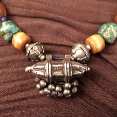 From North India (Himalaya area) a nice multi-stones necklace with a pretty silver pendant typical from Rajasthan with these small silver balls...