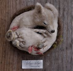'Vulpes vulpes somnium'  His gentle body lays still whilst he dreams of warmer days  A needle felted sleeping fox created by www.facebook.com/TheWhisperingWild