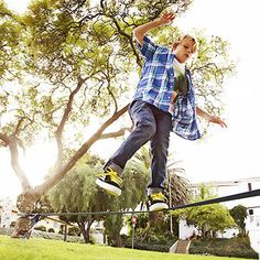 Build a Backyard Slackline: Setting up a slackline in your backyard provides the thrills and challenges of tightrope walking on a smaller (and safer!) scale.